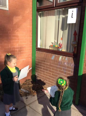 Enjoying a letter sound hunt outside