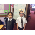Making paper hats in the style of Chanel.
