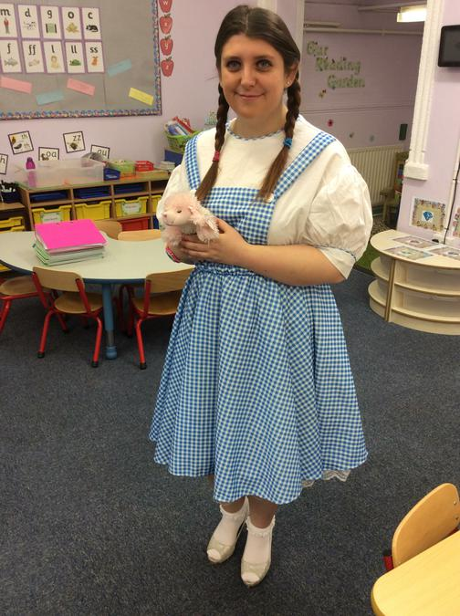 Miss Skelly as Dorothy with Toto