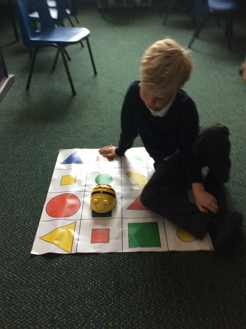 We are programming  Beebots to travel around a map