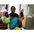Mrs Hiunt bought the school two parrot puppets.