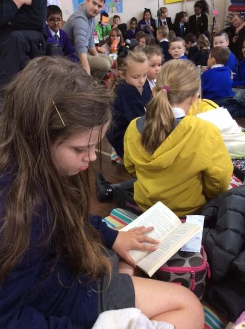 One of our Year 5 ambassadors enjoying her book.