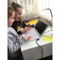 Hana completing some activities on mymaths.com.