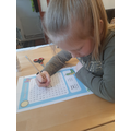 Emily completing her days of the week wordsearch