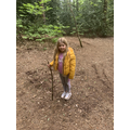 Ellsie out on a nature walk through the woods.