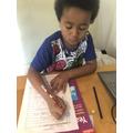 David completing the animal alphabet activity.