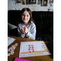 Kaya using a place value grid to help her with her maths!