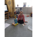 Clara stacking objects using positional language
