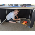 Building caves in class as part of class book Stone Age Boy