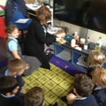 A group of children investigate liquids.
