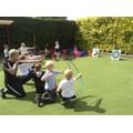 Games club children participate in archery.