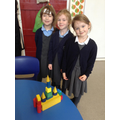 3D shapes to build a model and identify shapes.