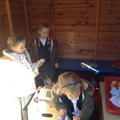 Children playing in the play shed.