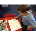 A child sketches their own 'Hunters in the Snow'