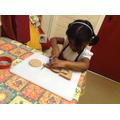 child making her open sandwich.