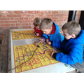 Children playing snakes and ladders.