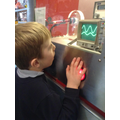 child looks at frequency levels.