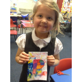 A child shows off her notebook