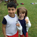 Class 2 children collecting bugs.