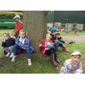 Class 2 have a rest under a tree.