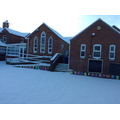 Back of school under snow cover.