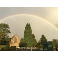 Local St Andrew's Church under a rainbow