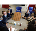 A group of children investigate if honey is runny.