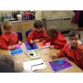 Children paint a Winter Tree Silhouette.