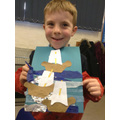 A child with his finished ship picture.