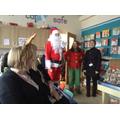 Santa arrives with his Head Elf.