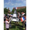 Children holding the Eifle Tower.