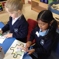 Children colouring and cutting.