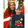 Head Elf has a photo with a child.