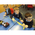 Children braid together to make a strong rope