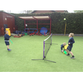 Children playing tennis in the Monday tennis club.