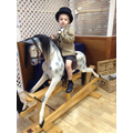 Child on a rocking horse.