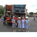 Children at the back of the recycling lorry.