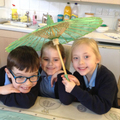 Children learn why sun parasols are used
