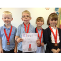 Children with their 3rd place tennis medals.