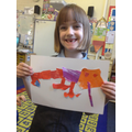 A child with her finished Chameleon picture.