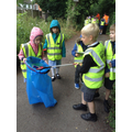 Class 2 work together to collect litter.