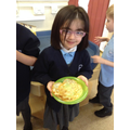 Child with her finished pancake.