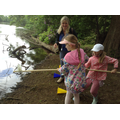 Class 2 children collect water from the lake.