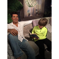 Mr Cowell, listens to child reading.