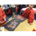 Creating sparkly firework paintings.