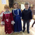 Children dressed in Victorian costumes.