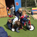Children working together on the scooter.