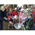 Children collect 2 cups of lake water during task