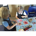 Children paint their concentric circles.