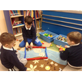 playing with small world toys in breakfast club.